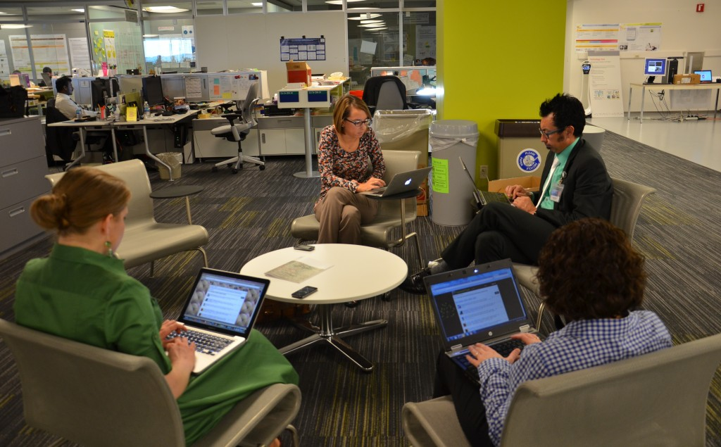 Center of Innovation team members sitting in a circle participating in a Tweet Chat