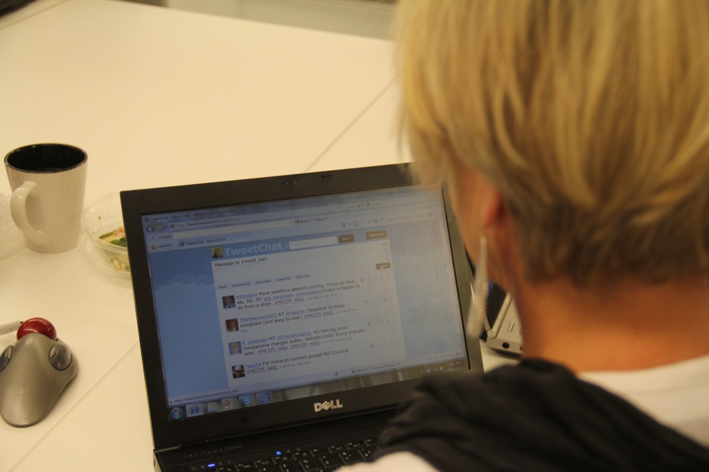 Over the shoulder shot of an individual participating in a Tweet Chat