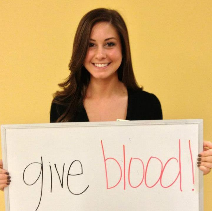 "Mary Bundrick holds a sign saying ""Give Blood!"" What a marketer!"