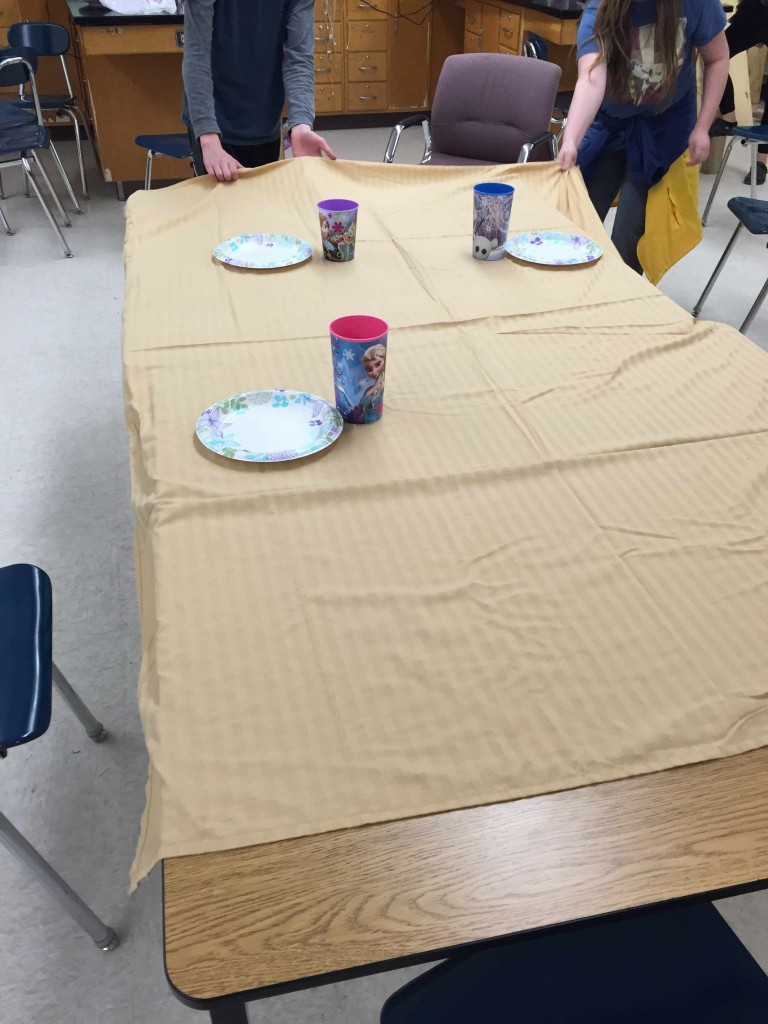 Can we pull off the table cloth without the plates falling off?