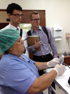 Brent Berry and Ephraim Ben-Abraham address concerns about a piece of endoscopy equipment.