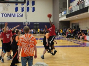 State Competition at St. Thomas University. Rochester athlete drives in for a lay up. Photo by Lori Torgerson