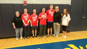 Rochester Special Olympic basketball athletes with their volunteer coaches. Photo by Lori Torgerson