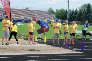 Special Olympic athlete competing in the long jump. Photo credit goes to Lori Torgerson.