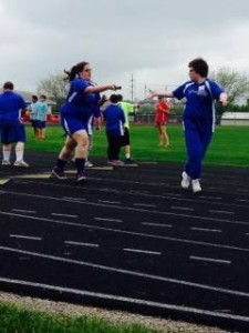 Athletes competing in the 4X100 relay race. Photo credit goes to Lori Torgerson.