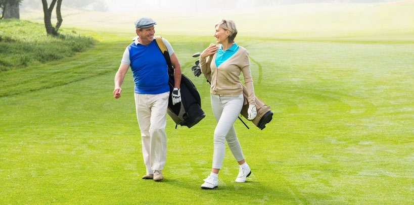 older couple on a golf course