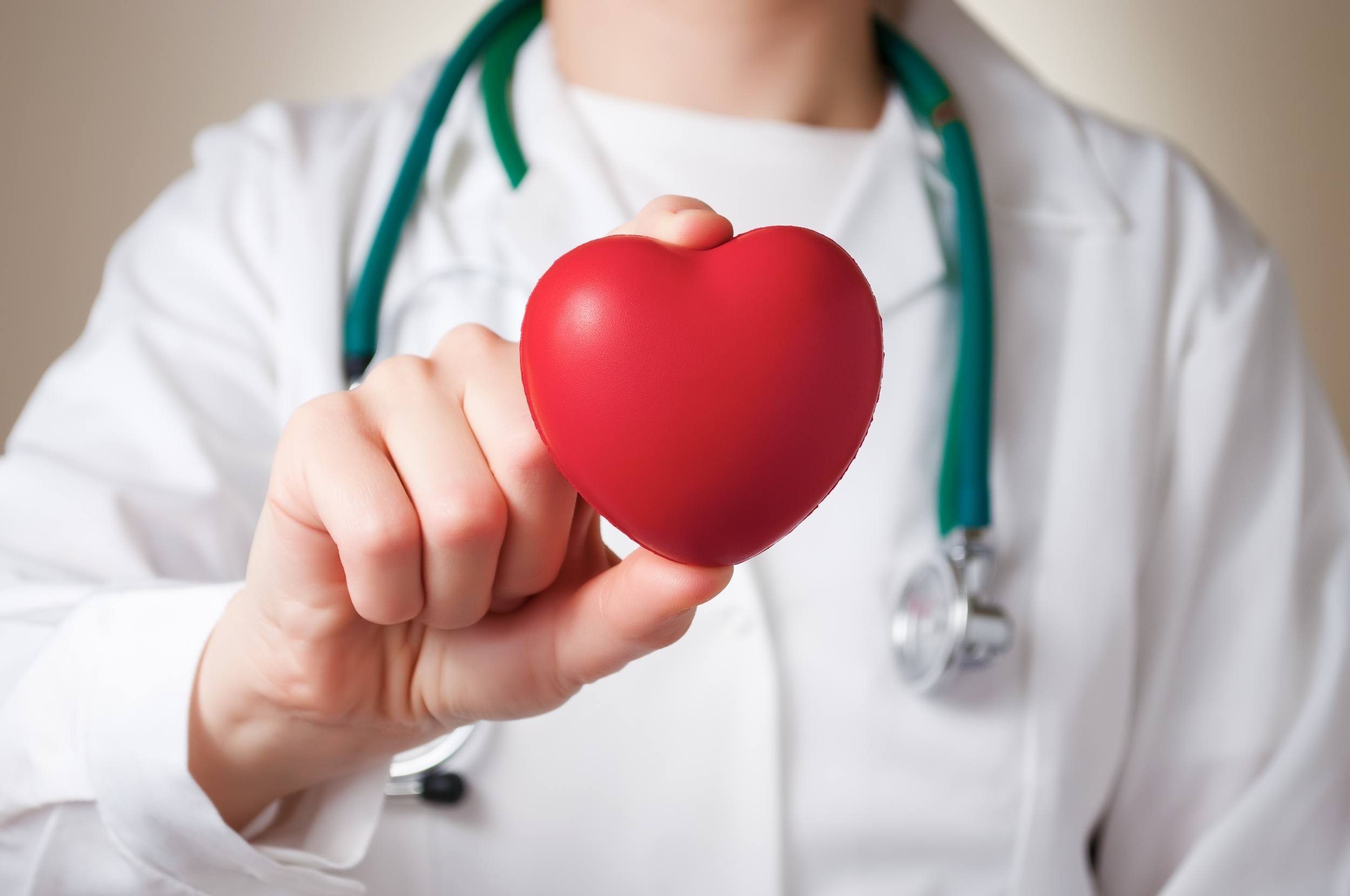 Red-heart-in-the-hand-of-a-physician_shutterstock_135683396