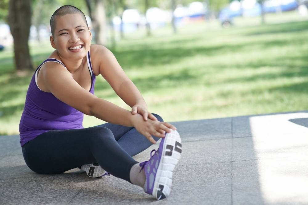 Vietnamese-bald-woman-doing-exercising-outdoors_shutterstock_346177118