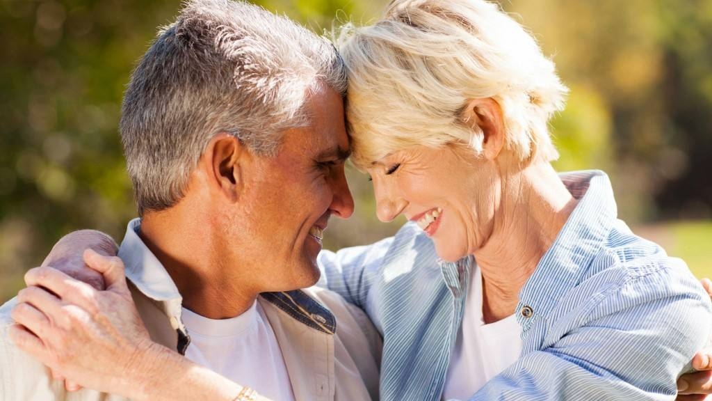 middle-aged-couple-outside-hugging-in-the-sunshine-16x9-1024x576
