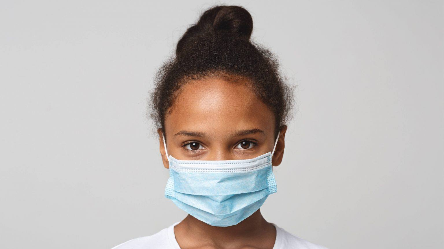 a-little-Black-school-aged-girl-with-a-plain-white-background-and-wearing-a-face-mask-16x9-1-1536x864