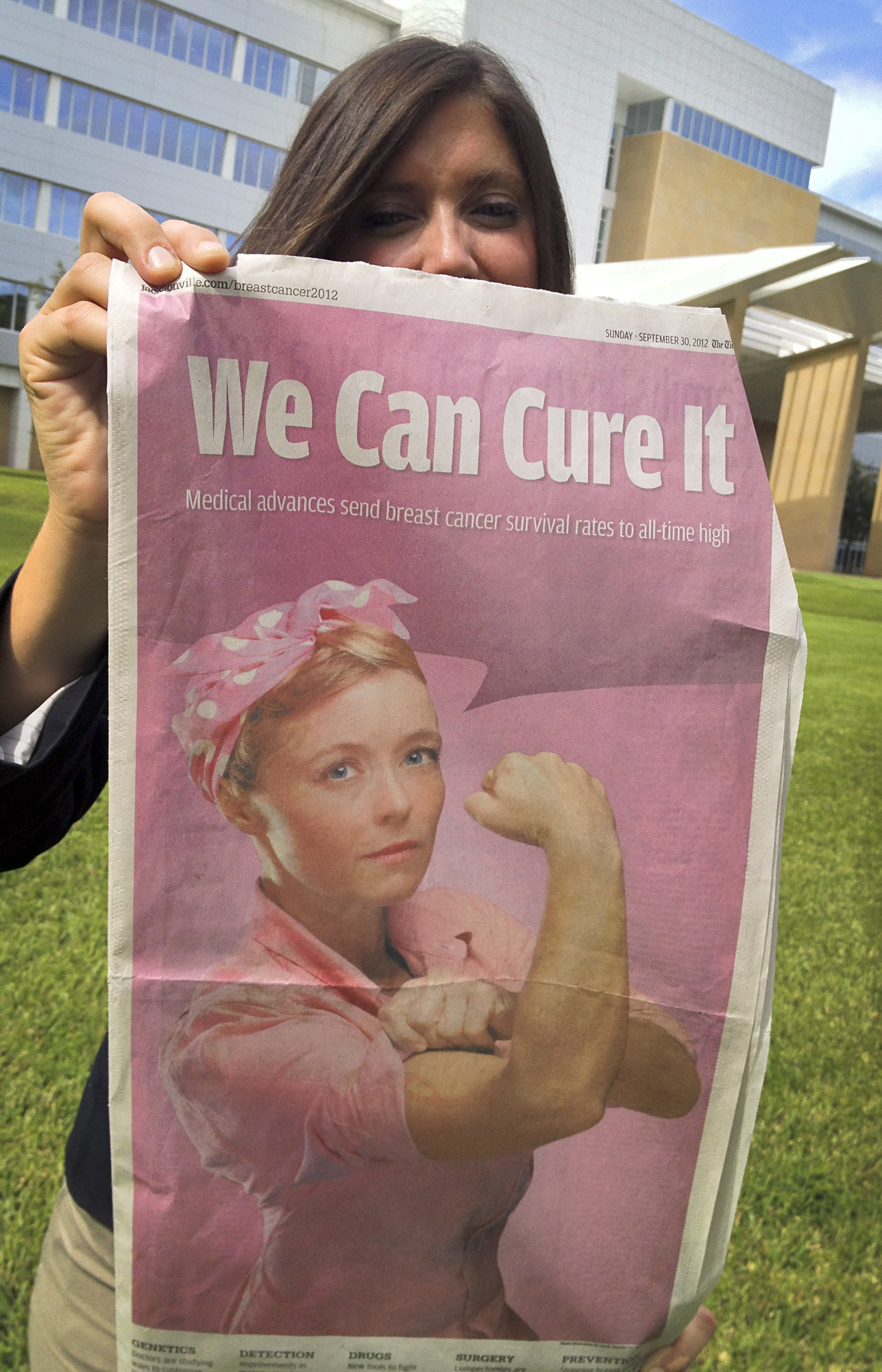 "Female outside of Mayo Clinic in Florida holding a copy of The Florida Times-Union's ""Breast Cancer 2012: We Can Cure It"" special section."