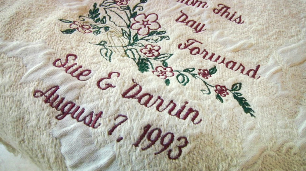 "blanket that reads ""From this day forward Sue and Darrin, August 7, 1993"""