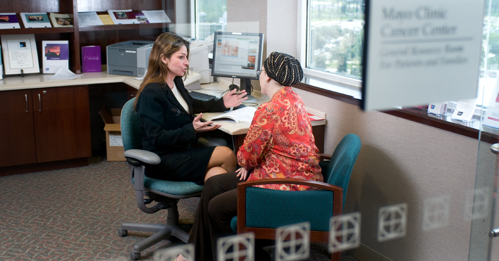 Stephanie L. Hines, M.D., a doctor of internal medicine, consults with a patient at Mayo Clinic.