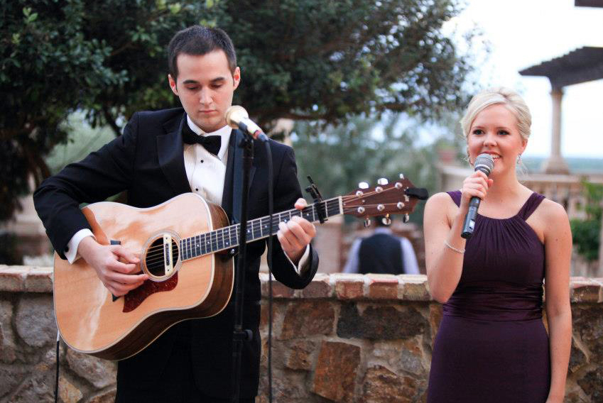 Todd Blake plays guitar as his wife Maja sings.