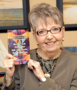 Elaine Ginn with her book, Patchwork