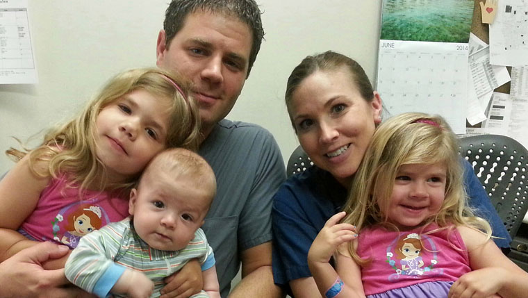 Brandon and Becky Mauck, with their children.