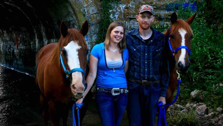 Joshua Russell and his fiancé, Ashley, take a break during a horse ride.