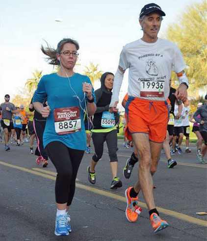 Don Salamone  and Linda Staley run in 10K race.