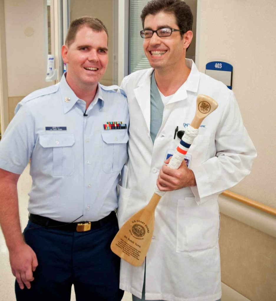 Sean Bretz with Neurosurgeon Rabih Tawk, M.D., a year after his stroke at 24.