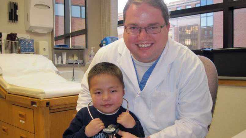 Dr. Brandon Phillips with a young patient.