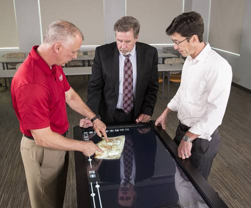 Conrad Dove, Dr. John Casler and Chad Thompson discuss surgical approach through 3-D modeling.