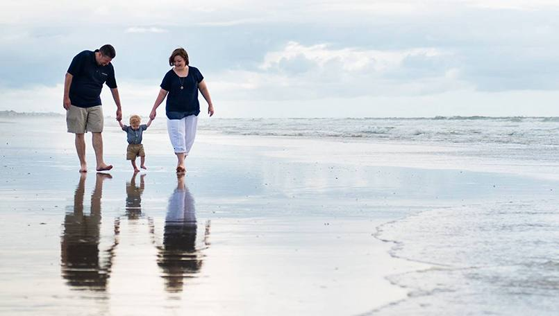 Collin Markum, shown walking on the beach with his family, was shocked to learn he had a rare cardiac condition that required open-heart surgery. Now after successful surgery and rehabilitation, Collin is working to help fund research and promote heart health.