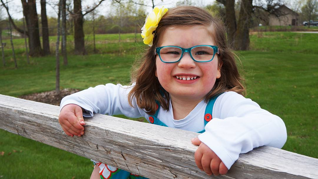 Affected by a rare, genetic condition that can cause severe developmental delays, Vera Johnson is happy and thriving in the world her parents have built for her with support from her Mayo Clinic team.