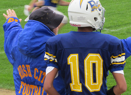 Shoulder Injury Can't Sideline Young Coach