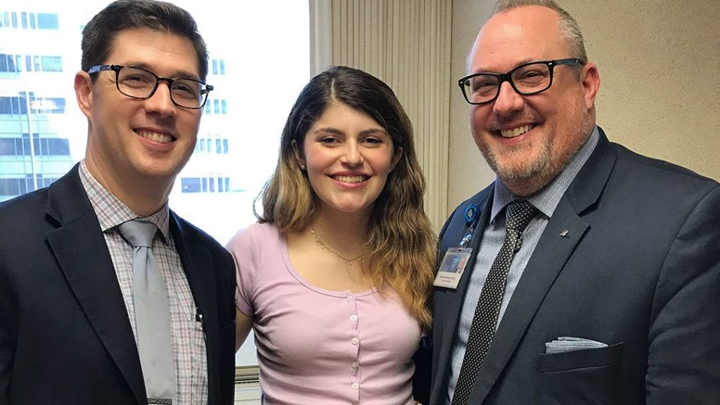 Carys Rees-Baker with Jonathan Fillmore, M.D., D.M.D., and Chad Rasmussen, D.D.S.