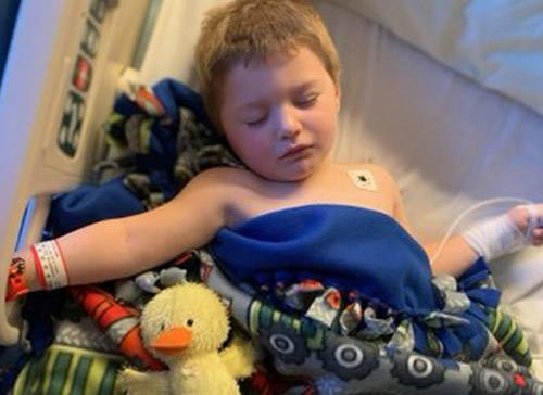Volunteer's gift provides warming comfort for young boy after head injury