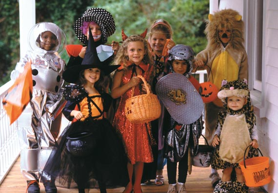 Group of children dressed up in Halloween costumes
