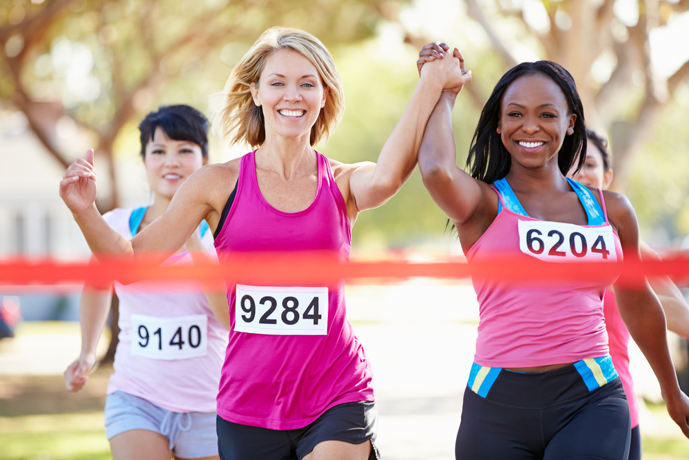 two women marathon runners running in race