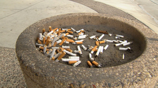Cigarette butts in outside sand container