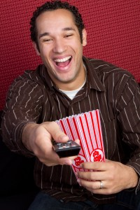 Guy at movie laughing