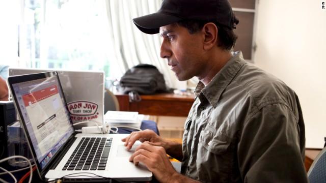 CNN chief medical correspondent Dr. Sanjay Gupta typing on his laptop