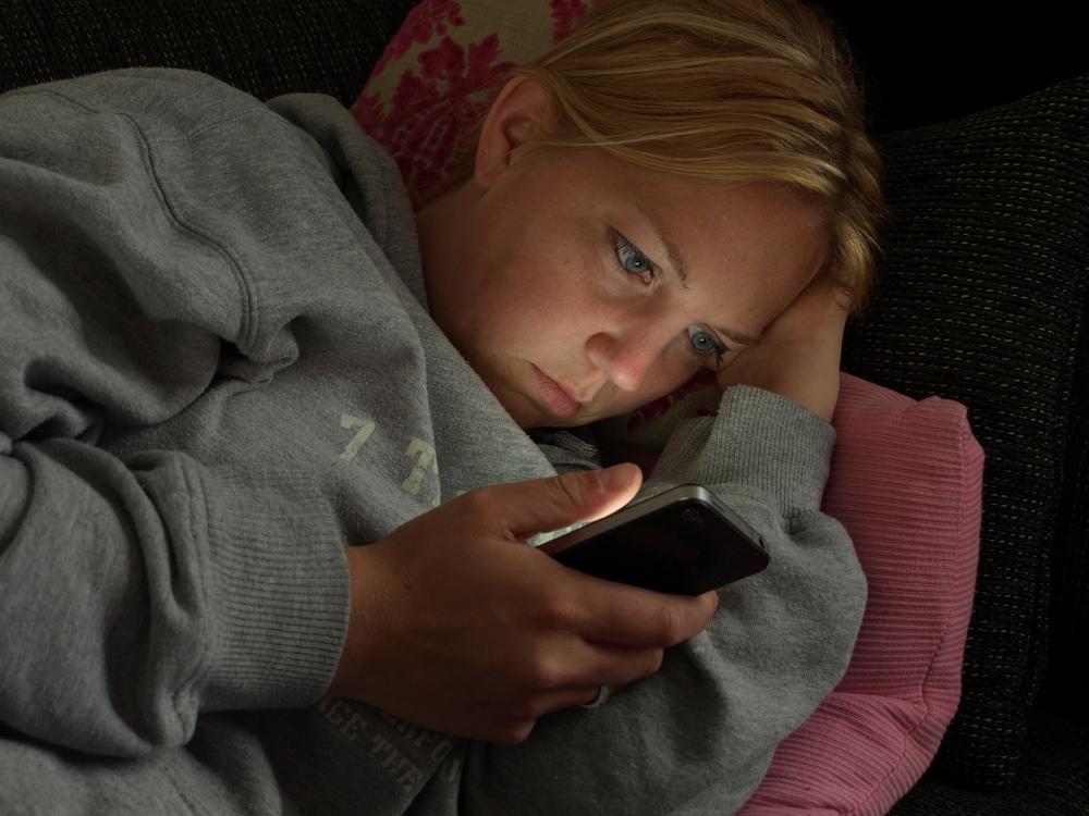 Browsing smartphone at night