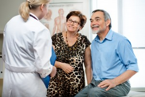 Senior couple consulting with physician