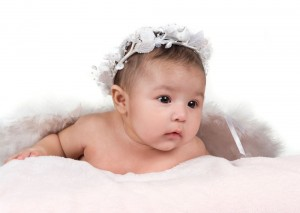 Hispanic baby girl with flower headband