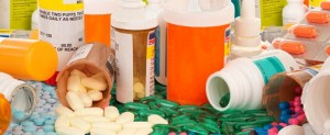 Prescription bottles with medication pills spilling out of the bottles