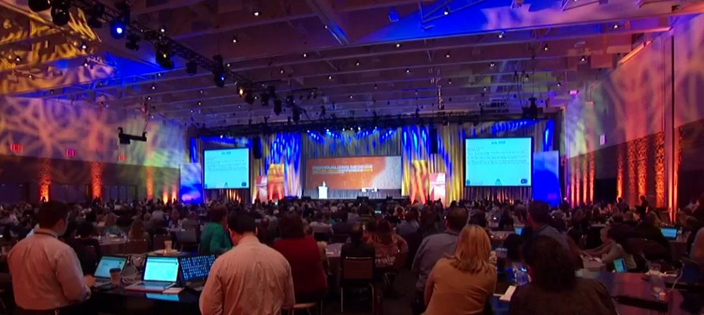 """Attendees fill the main hall of Mayo Clinic's """"Promise to Practice"""" genomics conference."""