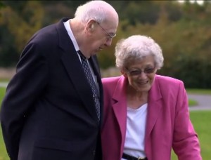 Outside photo of benefactors Patricia Kern in pink jacket and Robert Kern in navy jacket