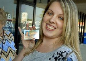 Nicole smiling and holding her drivers license