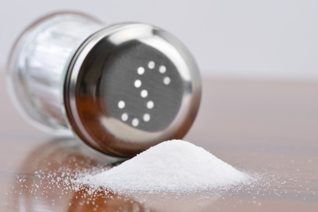 Silver saltshaker with spilled salt