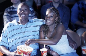 African American couple smiling and laughing in theater