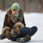Woman hurts leg in winter fall