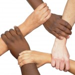 multi racial hands holding each other