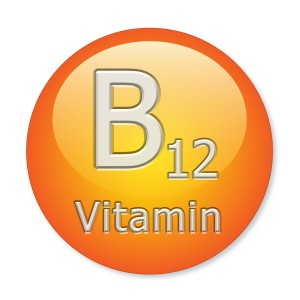 Orange and yellow graphic image of round vitamin B12