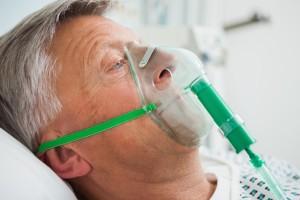 close-up of man wearing a respirator