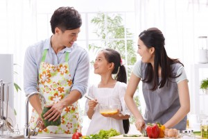 Family preparing meal in kitchen together