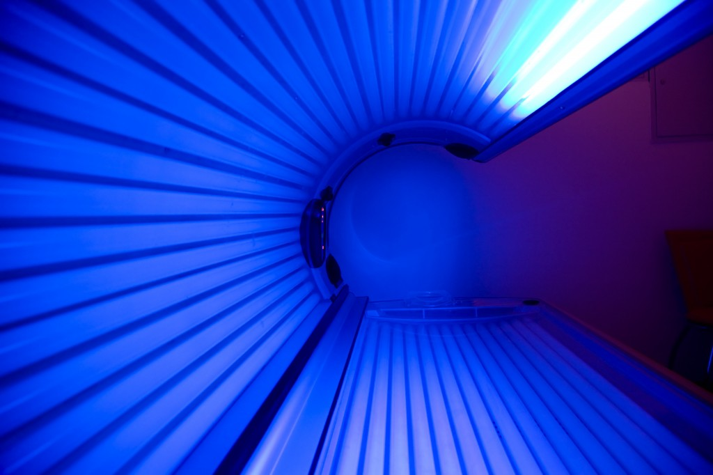 Inside tanning bed with blue lights